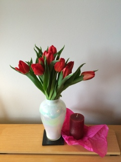 Beautiful tulips and a new candle