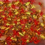 tumbling autumnal leaves.