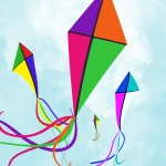four kites fluttering in the breeze